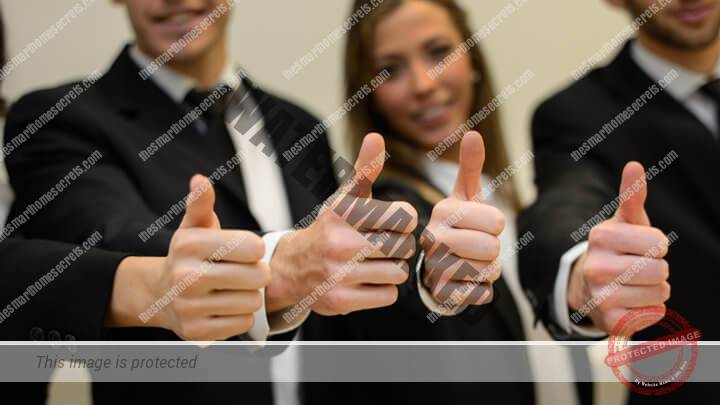 Customers holding their thumbs up