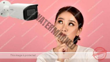 Woman concerned about security camera