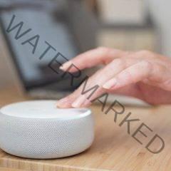 Woman turns Alexa volume down